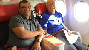 Air Asia CEO Tony Fernandes with Malaysia's ex Prime Minister Najib Razak on board Air Asia flight
